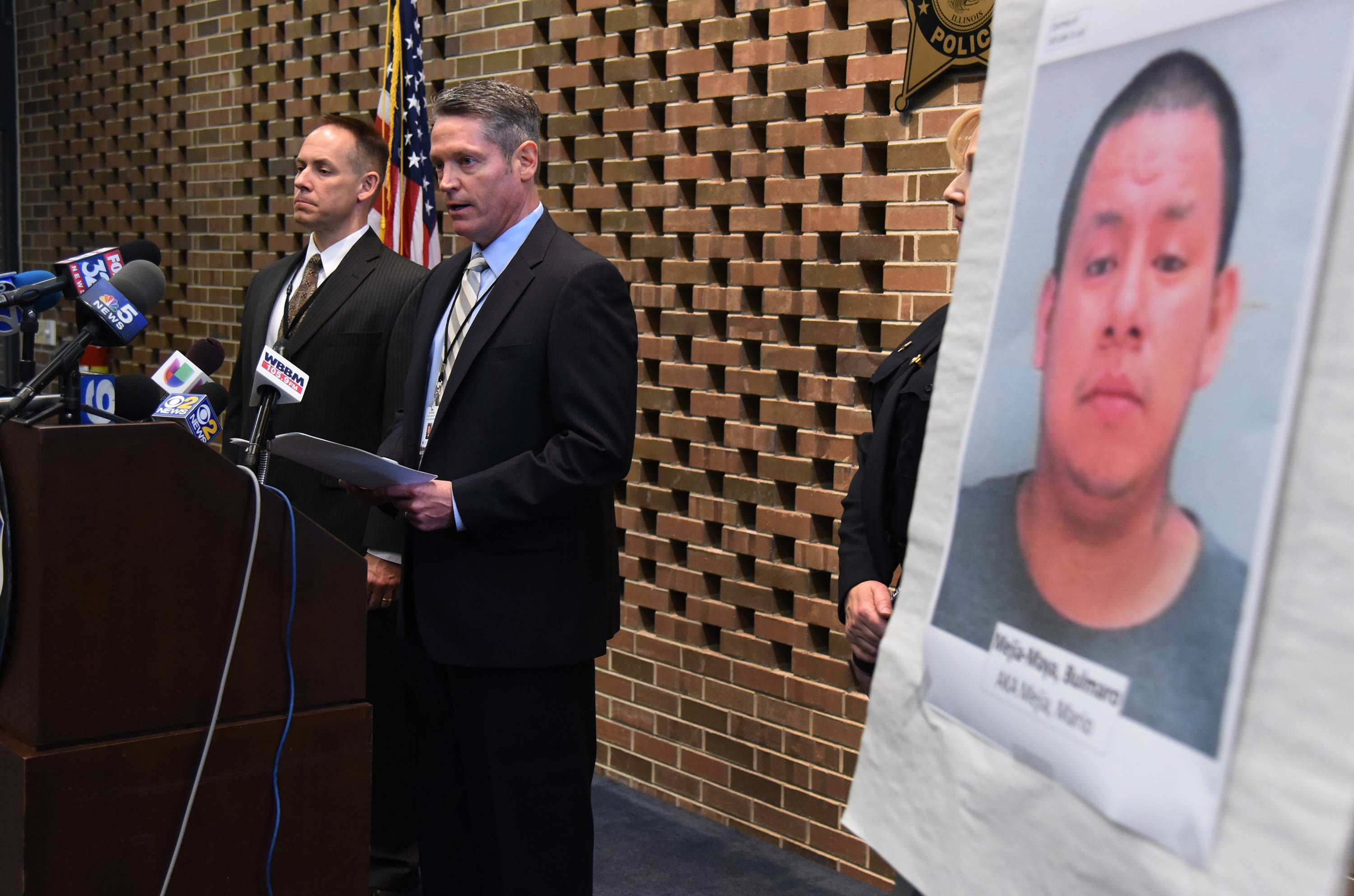 Schaumburg police Cmdr. Kurt Metzger speaks at a news conference Thursday to announce the arrest of Bulmaro Mejia-Maya, pictured at right. Police Lt. Michael DeGiulio is at the left.