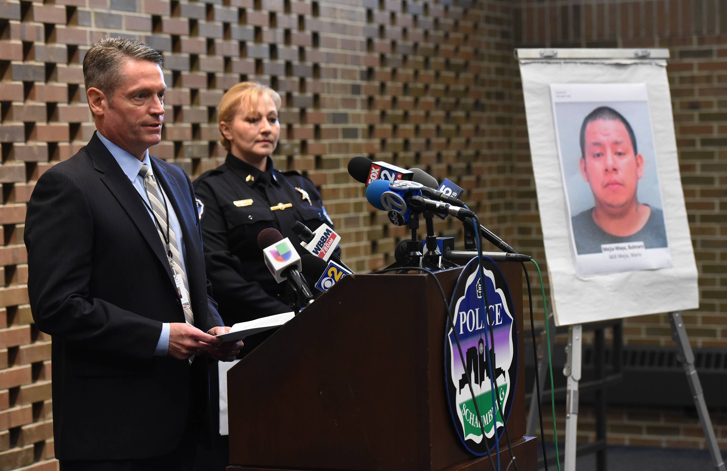 Schaumburg detective Cmdr. Kurt Metzger, left, and spokeswoman Sgt. Christy Lindhurst brief the media Thursday on the arrest of Bulmaro Mejia-Maya in connection with the strangulation of Tiffany Thrasher.