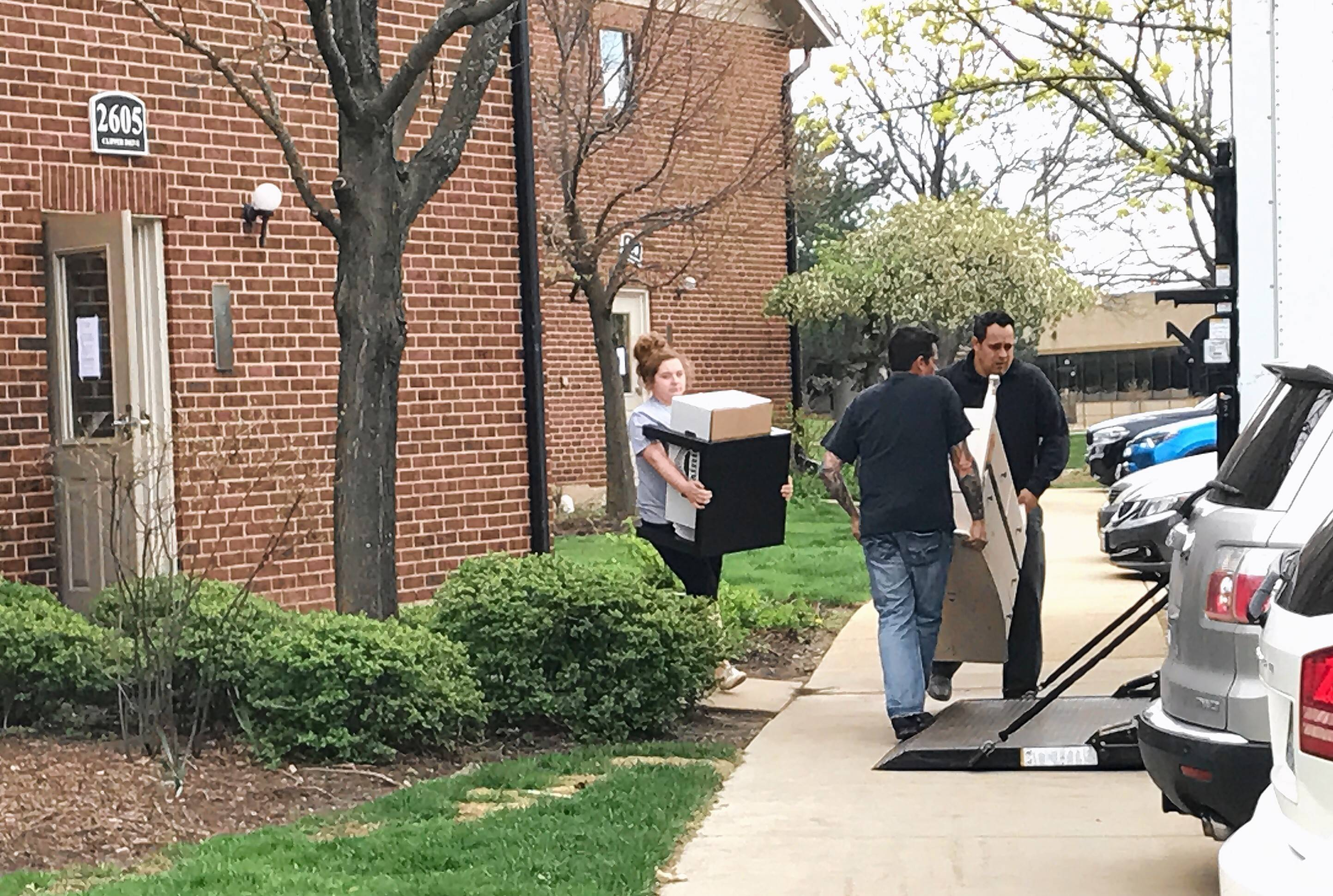 Family and friends of Tiffany Thrasher on Thursday began moving her belongings out of the Schaumburg apartment where she was murdered five days before.