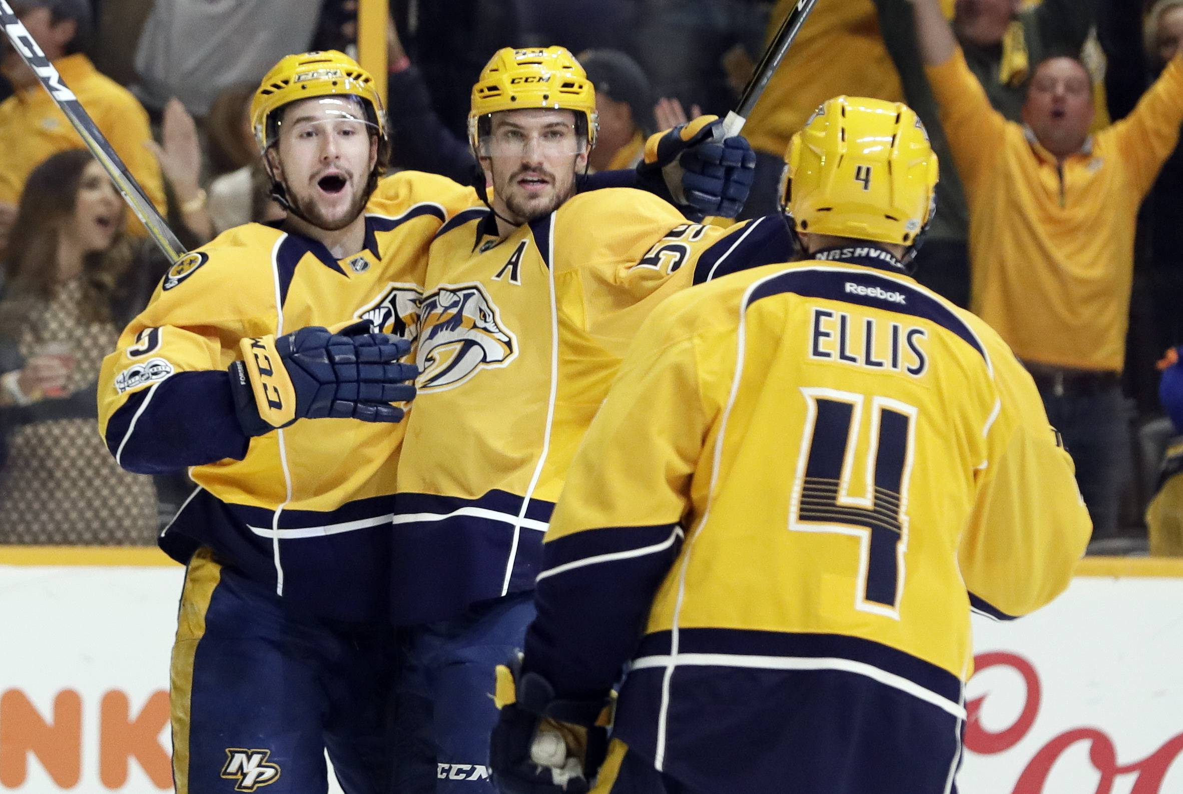 Nashville Predators defenseman Roman Josi (59), of Switzerland, celebrates with Filip Forsberg (9), of Sweden, and Ryan Ellis (4) after Josi scored against the Chicago Blackhawks during the second period in Game 4 of a first-round NHL hockey playoff series Thursday, April 20, 2017, in Nashville, Tenn.