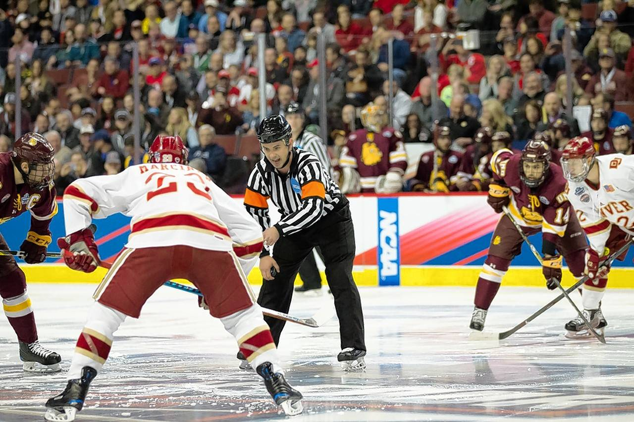 During the Frozen Four finals at the United Center, Colin Kronforst prepares for the biggest puck-drop of his officiating career.