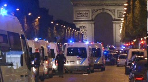 In this image made from video, police attend the scene after an incident on the Champs-Elysees in Paris, Thursday April 20, 2017. French media are reporting that two police officers were shot Thursday on the famed shopping boulevard.
