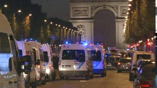 This image made from AP video shows police attending an incident on the Champs Elysees in Paris in which a police officer was killed along with an attacker in a shooting, Thursday April 20, 2017. French media are reporting that two police officers were shot Thursday on the famed shopping boulevard. Many police vehicles can be seen on the avenue that passes many of the city's most iconic landmarks.
