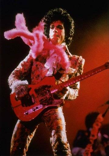 FILE - In this Jan. 11, 1985, file photo, Prince performs before a sold-out audience in Houston. Prince died at his his home on April 21, 2016. For Prince fans, the Friday, April 21, 2017, one-year anniversary of his shocking death from an accidental drug overdose will be a time for sadness and celebration. At his Paisley Park home and recording studio-turned-museum outside Minneapolis, four days of events are on tap, ranging from concert performances by his former bandmates to panel discussions on his legacy.