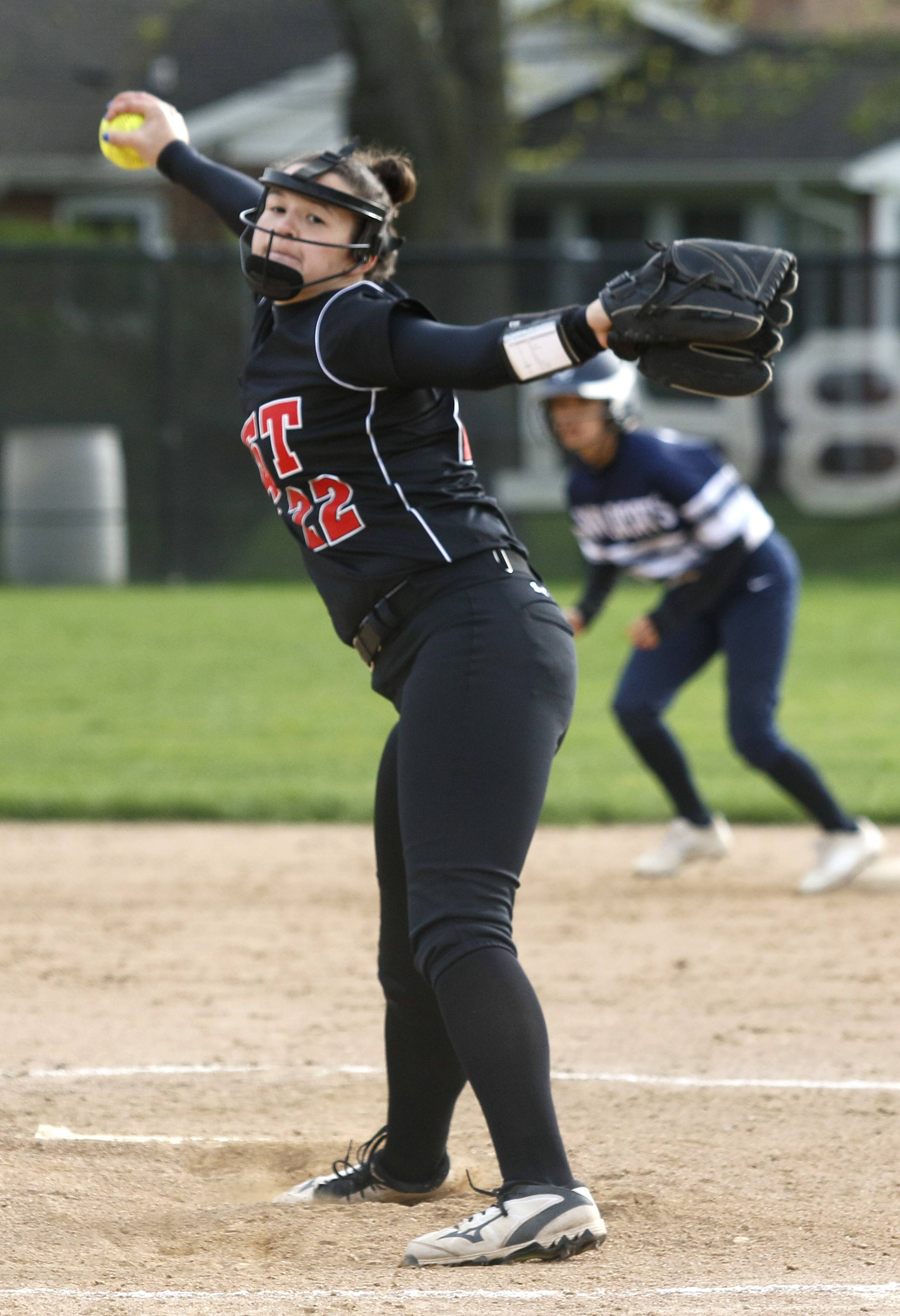 Glenbard East's Tori Tyler delivers a pitch against West Chicago during girls softball action in Lombard.