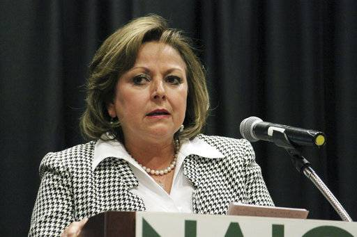 FILE - In this March 27, 2017 photo, Gov. Susana Martinez speaks about the recent legislative session to a group of business leaders and real estate developers during a luncheon in Albuquerque, N.M. The New Mexico Legislature sued Martinez, April 21 on Friday over her budget vetoes that would effectively eliminate the legislative branch pf government by cutting off its funding, escalating the clash over how to resolve the state's financial crisis. (AP Photo/Susan Montoya Bryan, File)