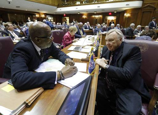 Rep. Charlie Brown, left, D-Gary, talks with Rep. B. Patrick Bauer D-South Bend during the session at the Statehouse Friday, April 21, 2017, in Indianapolis. Indiana lawmakers entered the day on what is expected to be the last day of their session with a hefty list of bills that still must be approved.(AP Photo/Darron Cummings)