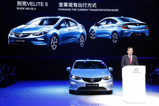 SAIC-GM president Wang Yongping announces the global launch of the Buick Velite 5, an extended range electric hybrid, during a global launch event ahead of the Shanghai Auto 2017 show in Shanghai, China, Tuesday, April 18, 2017. At the auto show, the global industry's biggest marketing event of the year, almost every global and Chinese auto brand is showing at least one electric concept vehicle, if not a market-ready model.