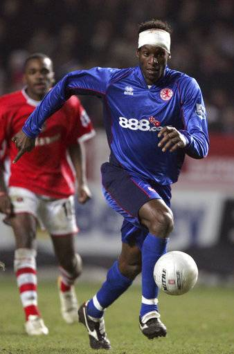 FILE - In this Thursday March 23, 2006 file photo, Middlesbrough's Ugo Ehiogu controls the ball during the English FA Cup sixth round soccer match against Charlton Athletic at the Valley stadium, London. Ugo Ehiogu, the former England defender who was a coach of Tottenham's under-23 team, died Friday April 21, 2017, after suffering a cardiac arrest. He was 44.