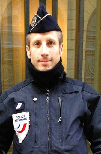 This undated image provided on Friday, April 21, 2017, by FLAG, an association of LGBT police officers, shows French police officer Xavier Jugele. The policeman killed on Paris' most famous boulevard was identified as Xavier Jugele by Flag! Its president, Mickael Bucheron, told AP the dead officer would have celebrated his 38th birthday at the beginning of May. (FLAG via AP)