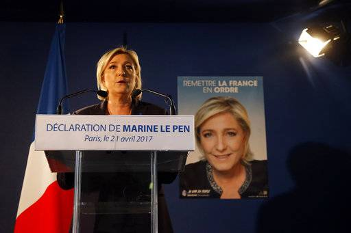 Far-right leader and candidate for the presidential election Marine Le Pen speaks in Paris, Friday, April 21, 2017, one day after the attack that killed one police officer and wounded three other people. Le Pen campaigns against immigration and Islamic fundamentalism.