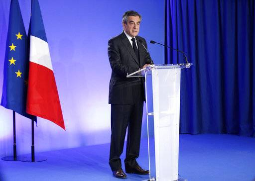 French conservative presidential candidate Francois Fillon speaks in Paris, Friday, April 21, 2017. France began picking itself up Friday from another deadly shooting claimed by the Islamic State group, with President Francois Hollande convening the government's security council and his would-be successors in the presidential election campaign treading carefully before voting this weekend.