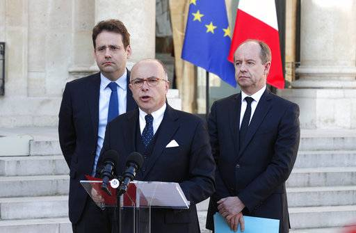 France's Interior Minister Matthias Fekl, left, Justice minister Jean-Jacques Urvoas, right, and Prime Minister Bernard Cazeneuve speak to the media after a defense and security council meeting at the Elysee Palace, in Paris, Friday, April 21, 2017. France began picking itself up from another fatal shooting claimed by the Islamic State group, with President Francois Hollande calling together his security council and with his would-be successors treading carefully before the election this weekend.