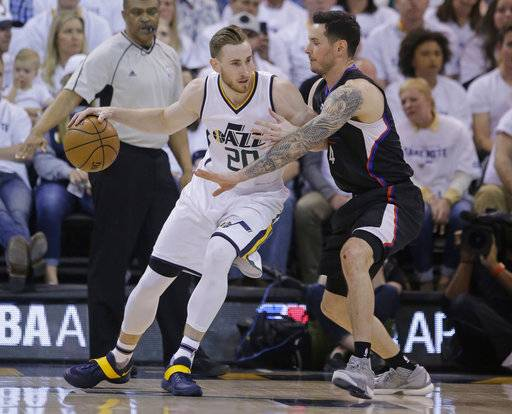 Los Angeles Clippers guard JJ Redick, right, guards Utah Jazz forward Gordon Hayward during the first half in Game 3 of an NBA basketball first-round playoff series Friday, April 21, 2017, in Salt Lake City. (AP Photo/Rick Bowmer)