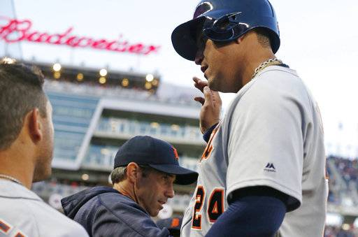Detroit Tigers' Miguel Cabrera enters the dugout after scoring on a double by Justin Upton off Minnesota Twins pitcher Hector Santiago during the third inning of a baseball game Friday, April 21, 2017, in Minneapolis. (AP Photo/Jim Mone)