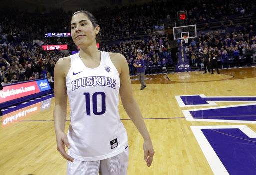 FILE - In this Feb. 25, 2017, file photo, Washington's Kelsey Plum smiles after an NCAA college basketball game against Utah in Seattle. Plum, the No. 1 pick in the WNBA draft, is happy to be in San Antonio and help be a key piece of the Stars' rebuilding project. (AP Photo/Elaine Thompson, File)