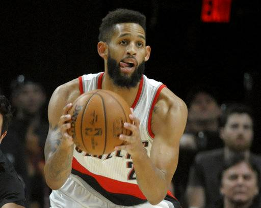 FILE - In this April 6, 2017, file photo, Portland Trail Blazers guard Allen Crabbe plays during the first half of an NBA basketball game against the Minnesota Timberwolves in Portland, Ore. It is clear to Crabbe, and just about everyone else who is watching, that Portland's bench needs to do more against the Warriors in the first round of the NBA playoffs. (AP Photo/Steve Dykes, File)