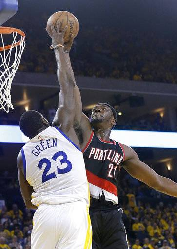 Golden State Warriors forward Draymond Green (23) blocks a shot attempt by Portland Trail Blazers forward Noah Vonleh during the second half of Game 1 of a first-round NBA basketball playoff series in Oakland, Calif., Sunday, April 16, 2017. The Warriors won 121-109. (AP Photo/Jeff Chiu)