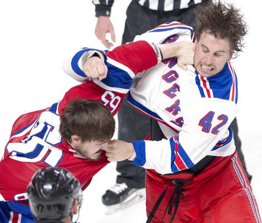 Montreal Canadiens center Andrew Shaw (65) and New York Rangers defenseman Brendan Smith (42) trade blows during the first period of Game 5 of a first-round NHL hockey Stanley Cup playoff series, Thursday, April 20, 2017, in Montreal. (Ryan Remiorz/The Canadian Press via AP)