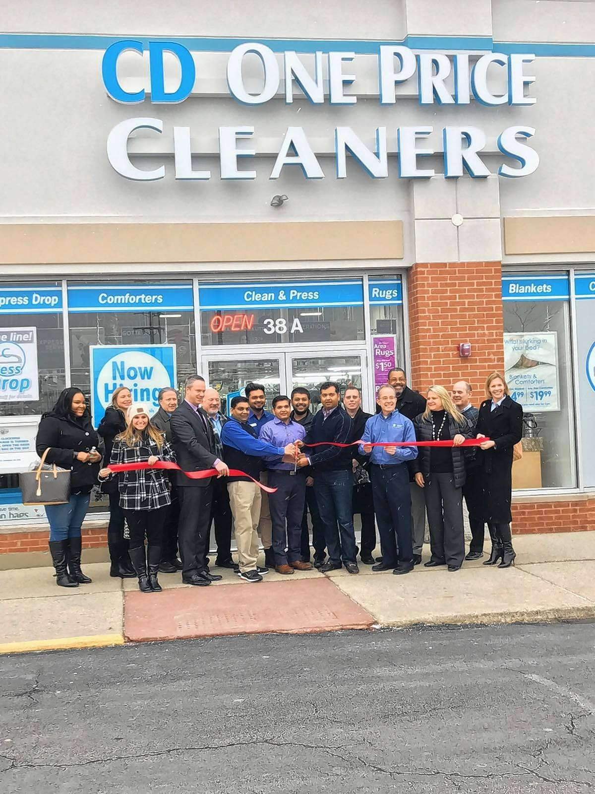 Owner J.D. Patel, at center holding giant scissors, had a ribbon cutting on his new CD One Price Cleaners franchise in Schaumburg. He held a grand opening last weekend.