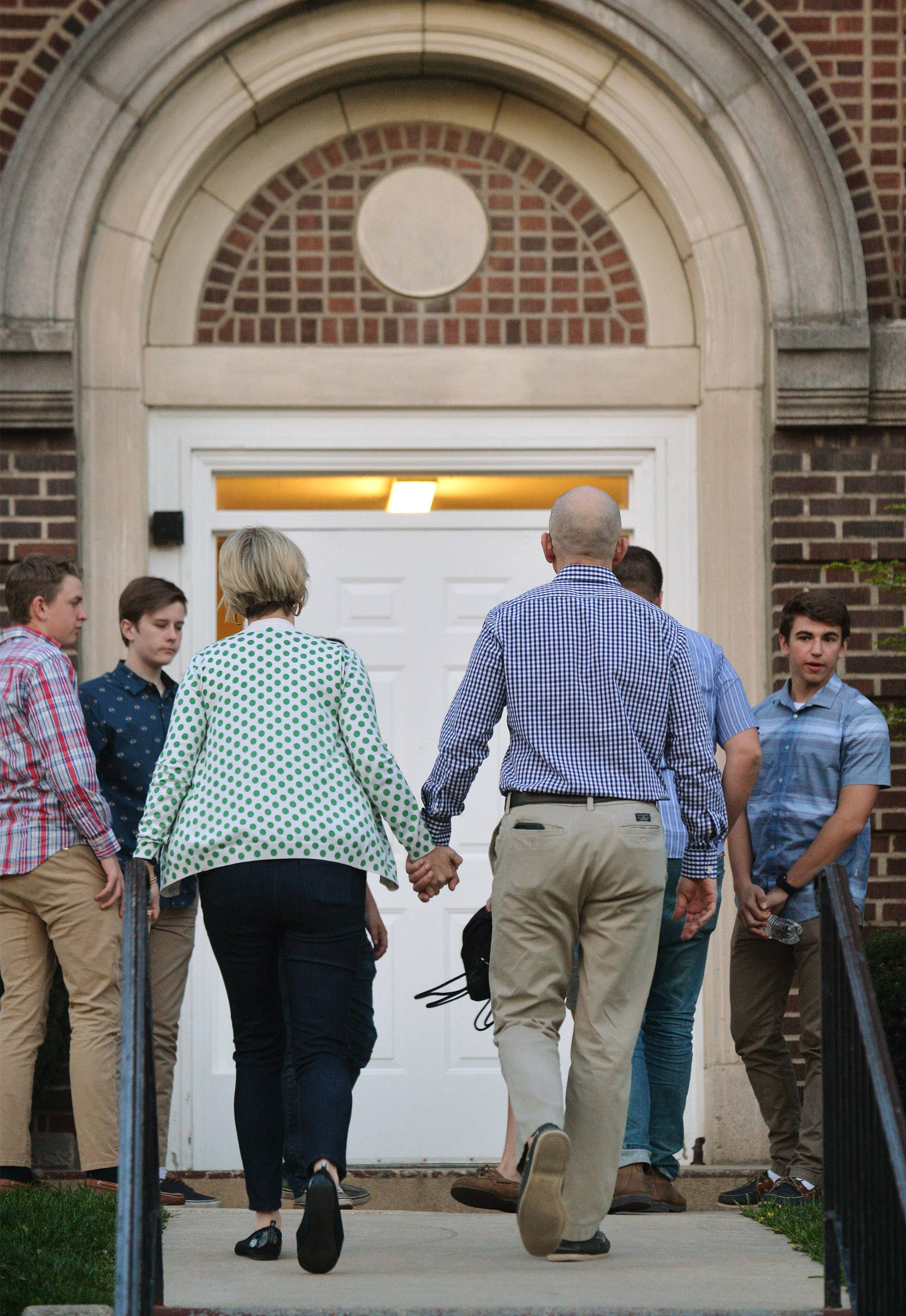 Worshippers enter Pierce Memorial Chapel Sunday for a service for the Wheaton College community after freshman Ethan Roser, 19, died.