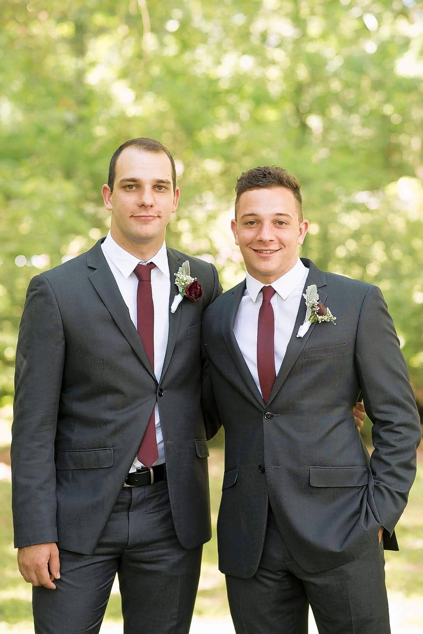 Ethan Roser, right, stands with his brother, Nathan Roser. Ethan was a freshman at Wheaton College and was studying theology. He died Saturday after being accidentally struck during a hammer throw event at a track and field meet.