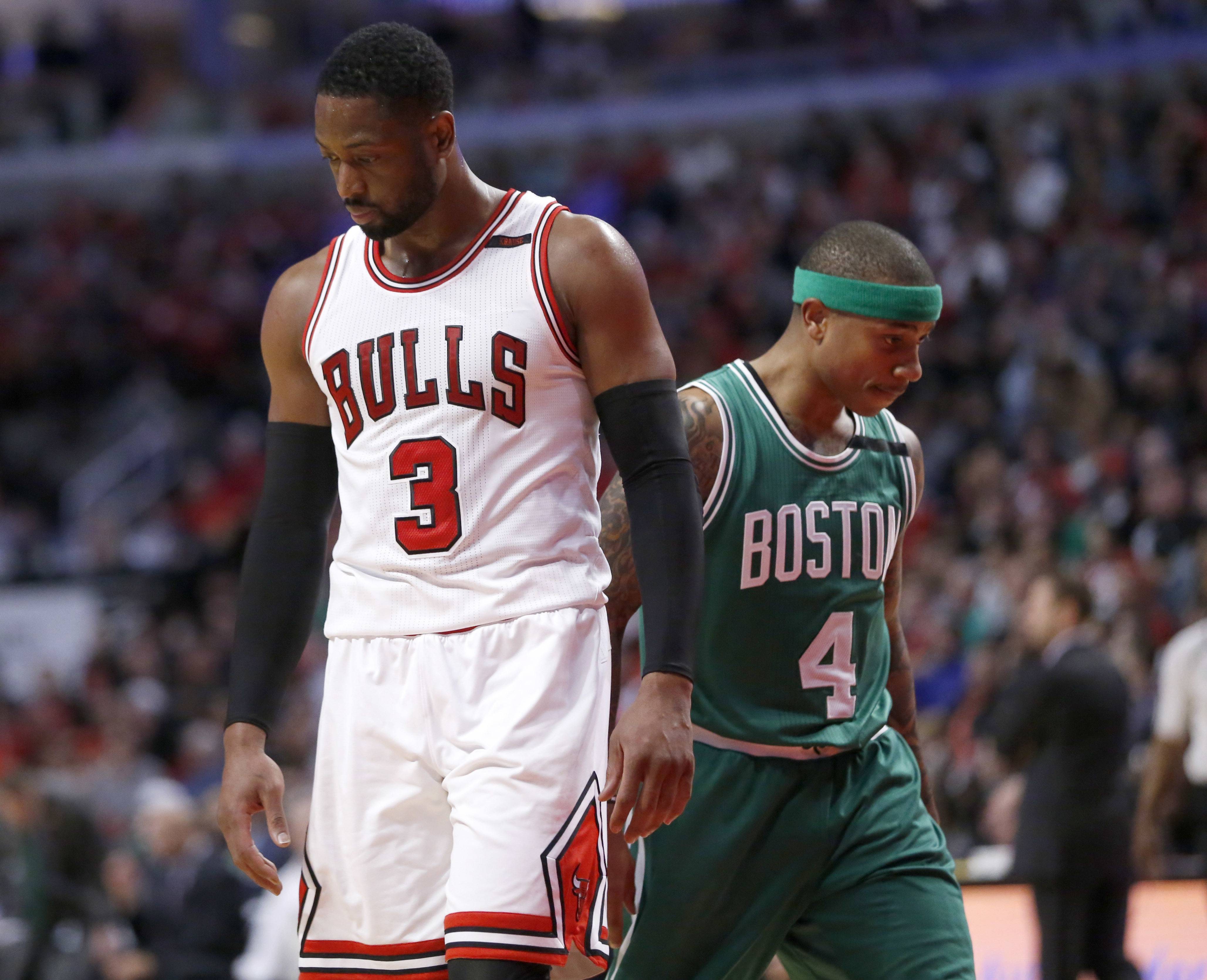 Chicago Bulls' Dwyane Wade (3) and Boston Celtics' Isaiah Thomas pass each other during the second half in Game 4 of an NBA basketball first-round playoff series in Chicago, Sunday, April 23, 2017. The Celtics won 104-95. (AP Photo/Charles Rex Arbogast)