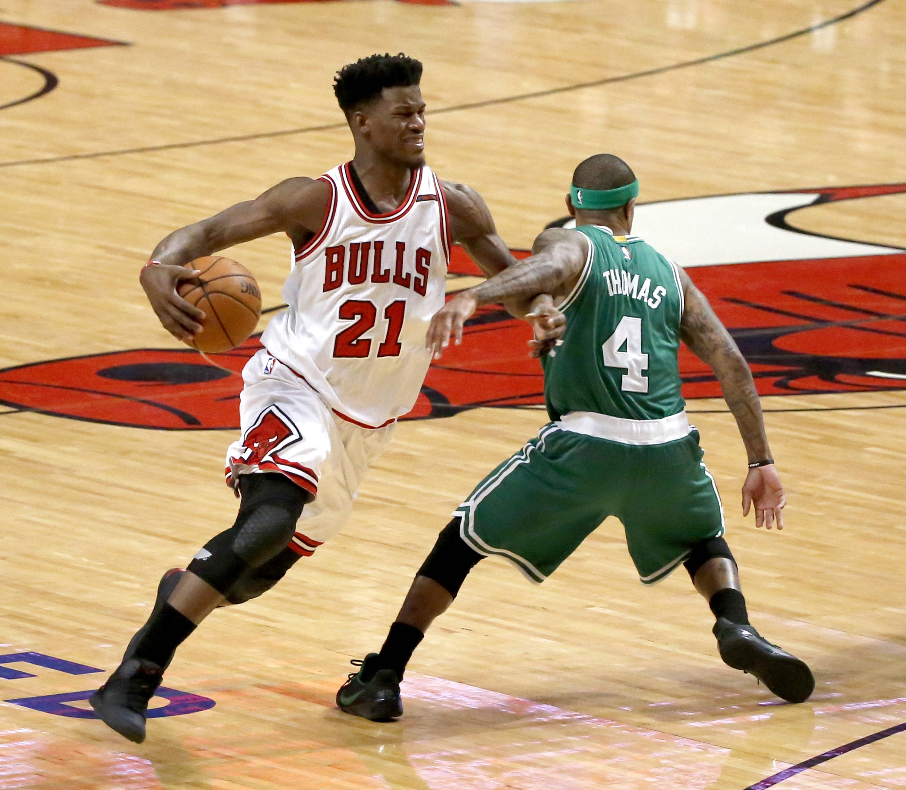 Chicago Bulls' Jimmy Butler (21) is fouled by Boston Celtics' Isaiah Thomas during the second half in Game 4 of an NBA basketball first-round playoff series in Chicago, Sunday, April 23, 2017. The Celtics won 104-95.