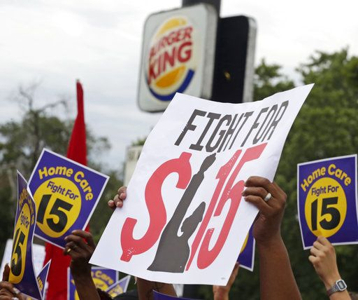 FILE - In this Sept. 14, 2014, file photo, protesters participate in a rally on Chicago's south side as labor organizers escalate their campaign raise the minimum wage for employees to $15 an hour. Amid a national push by unions and worker advocates for a $15 minimum wage, Illinois Democrats hope to pass an ambitious hike during the spring legislative session, despite a warning from Republican Gov. Bruce Rauner that he opposes an increase of any kind.