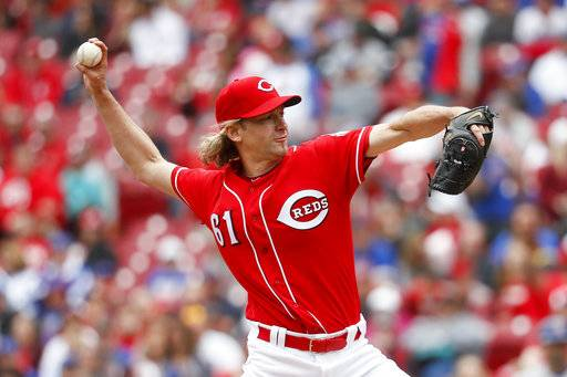 Cincinnati Reds starting pitcher Bronson Arroyo throws in the first inning of a baseball game against the Chicago Cubs, Sunday, April 23, 2017, in Cincinnati. (AP Photo/John Minchillo)