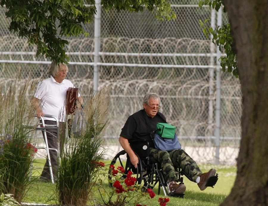 Former U.S. House Speaker Dennis Hastert, right, reports to the Federal Medical Center in Rochester, Minnesota, to begin serving a 15-month prison sentence.