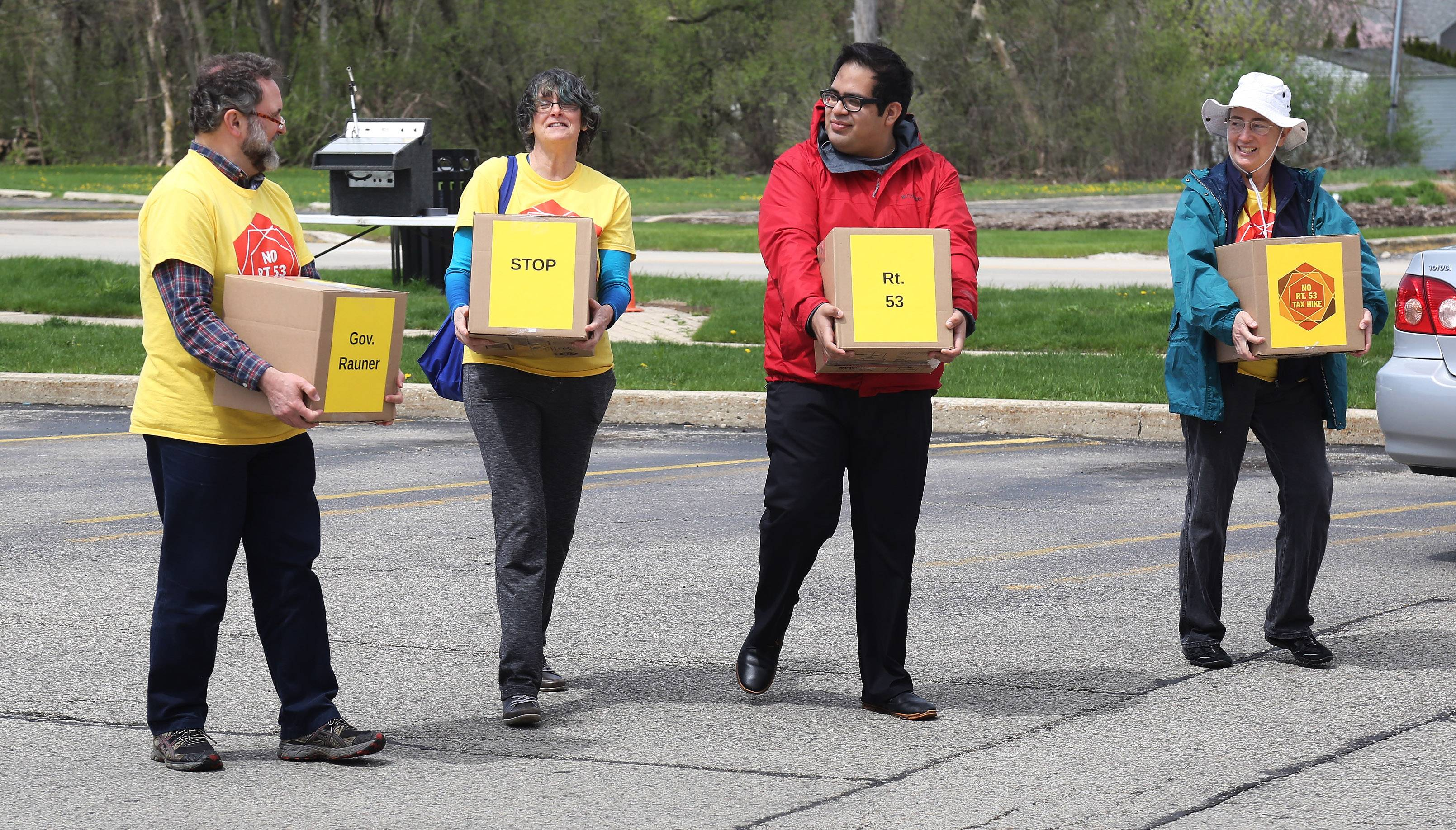 Activists opposed to the Route 53 extension deliver petitions addressed to Gov. Bruce Rauner on Thursday at the Mundelein post office. Opponents say the proposed road would pollute the air and nearby preserves.