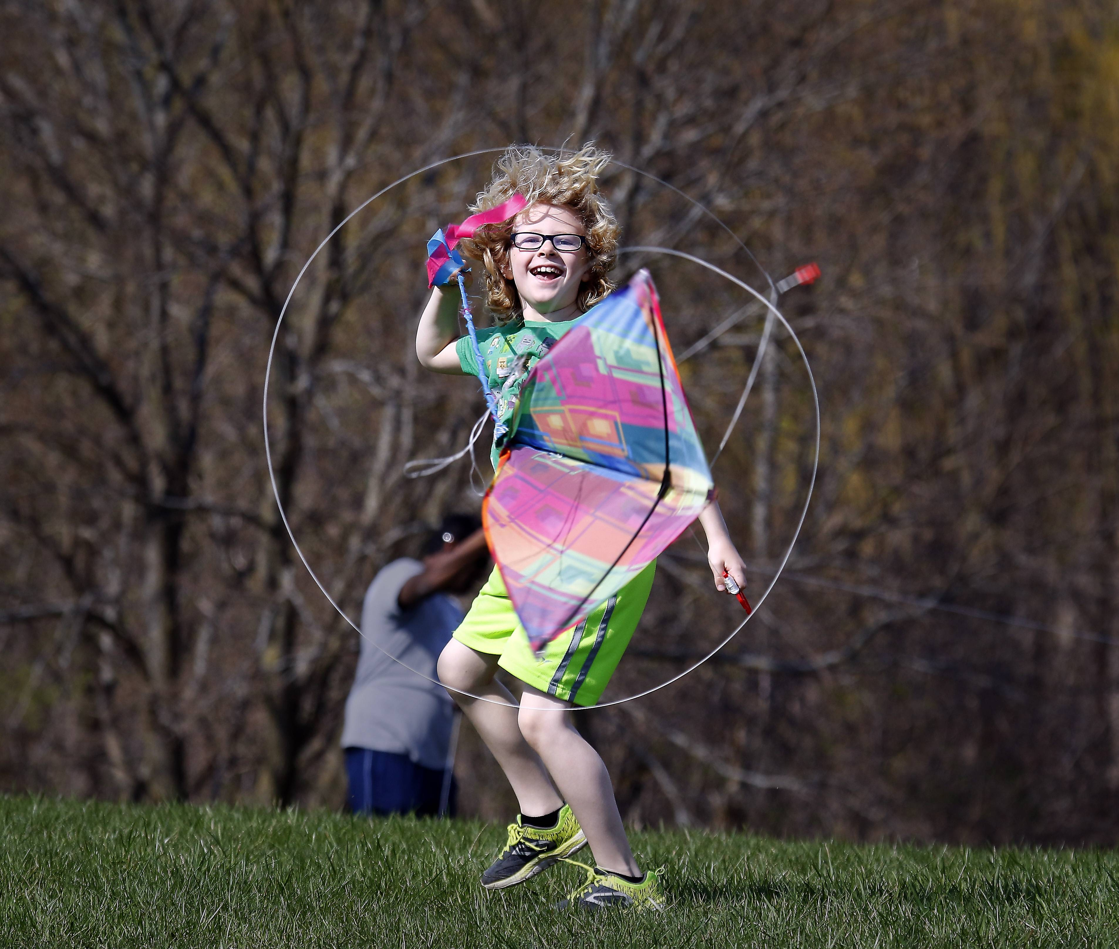 "Eight-year-old Miles Stahl, of Cary tries to launch his kite in the air Saturday during the Illinois Association of Park Districts' statewide ""Flying 4 Kids"" month at Lions Park, in Cary."