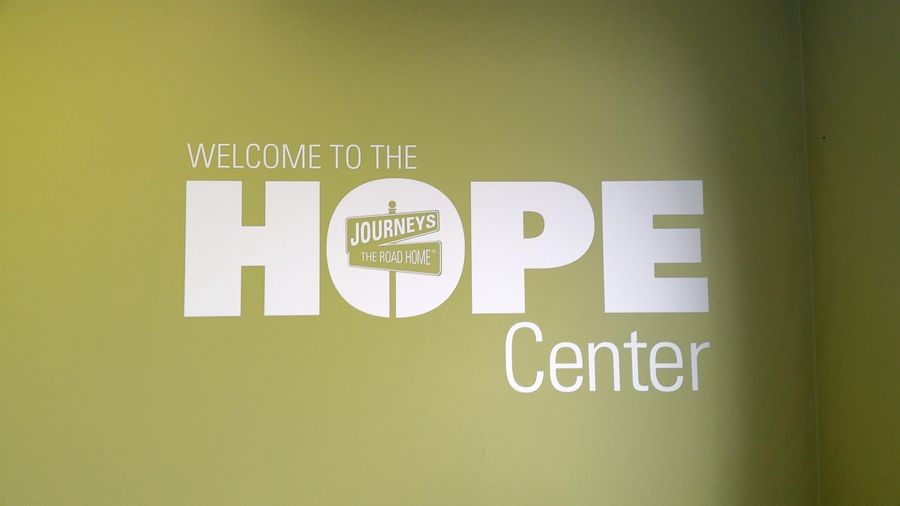 A sign welcomes clients to the Journeys HOPE Center.