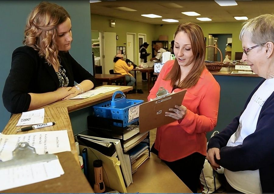 Volunteers and staff work the HOPE Center front desk. From left are Allyson Schnoor, Taylor Jacob and Pam Anderson.