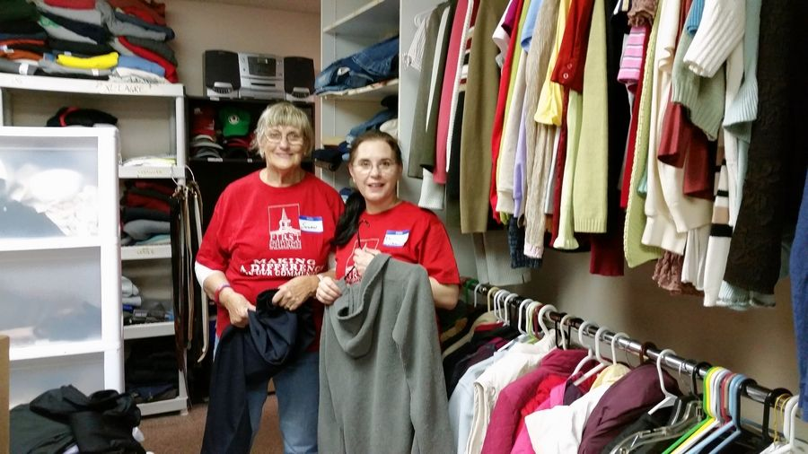 Volunteers from First Presbyterian Church in Arlington Heights work in the clothing closet during a service day at Journeys.