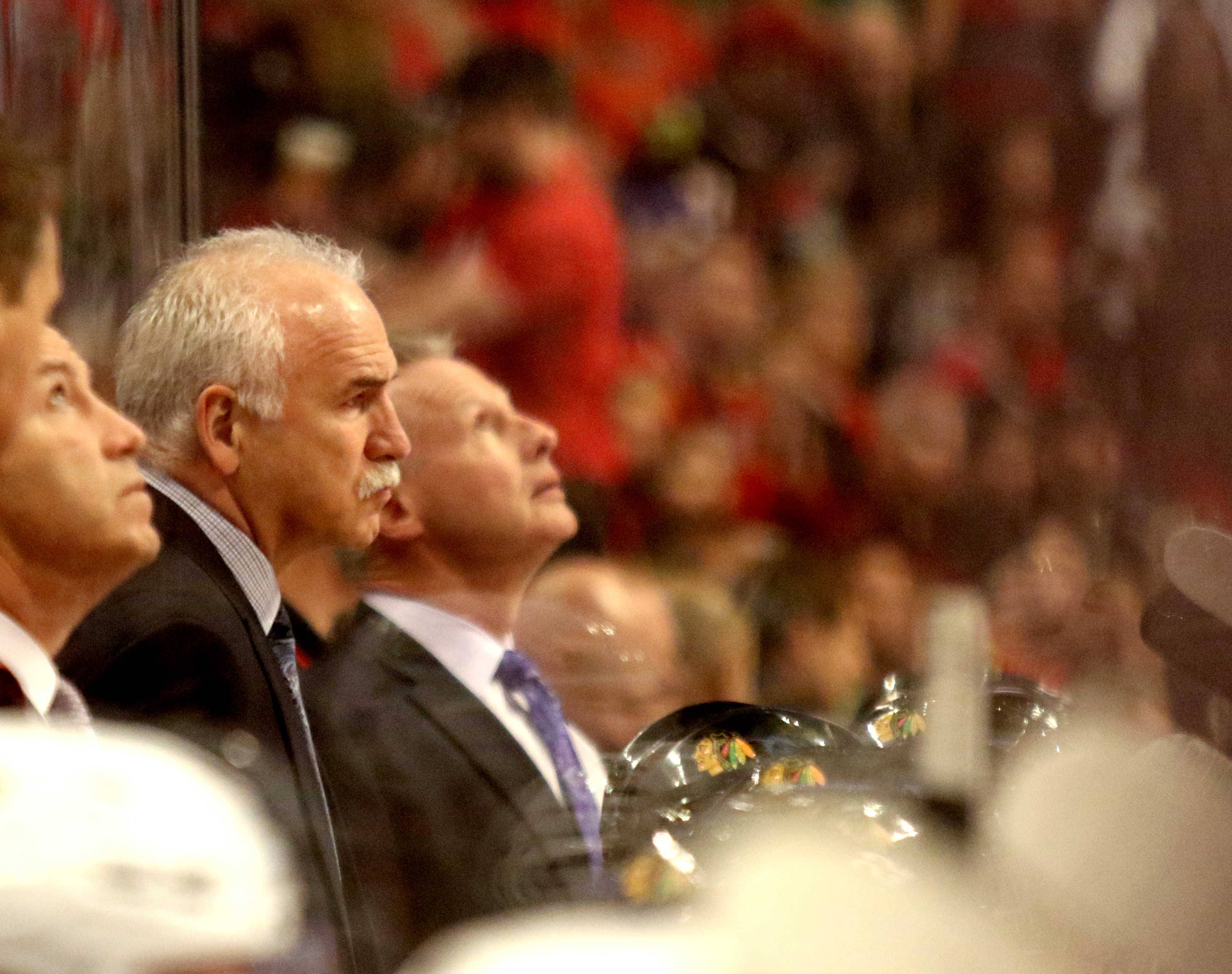 Assistant coach Mike Kitchen, standing to the right of head coach Joel Quenneville, has been fired by the Chicago Blackhawks.