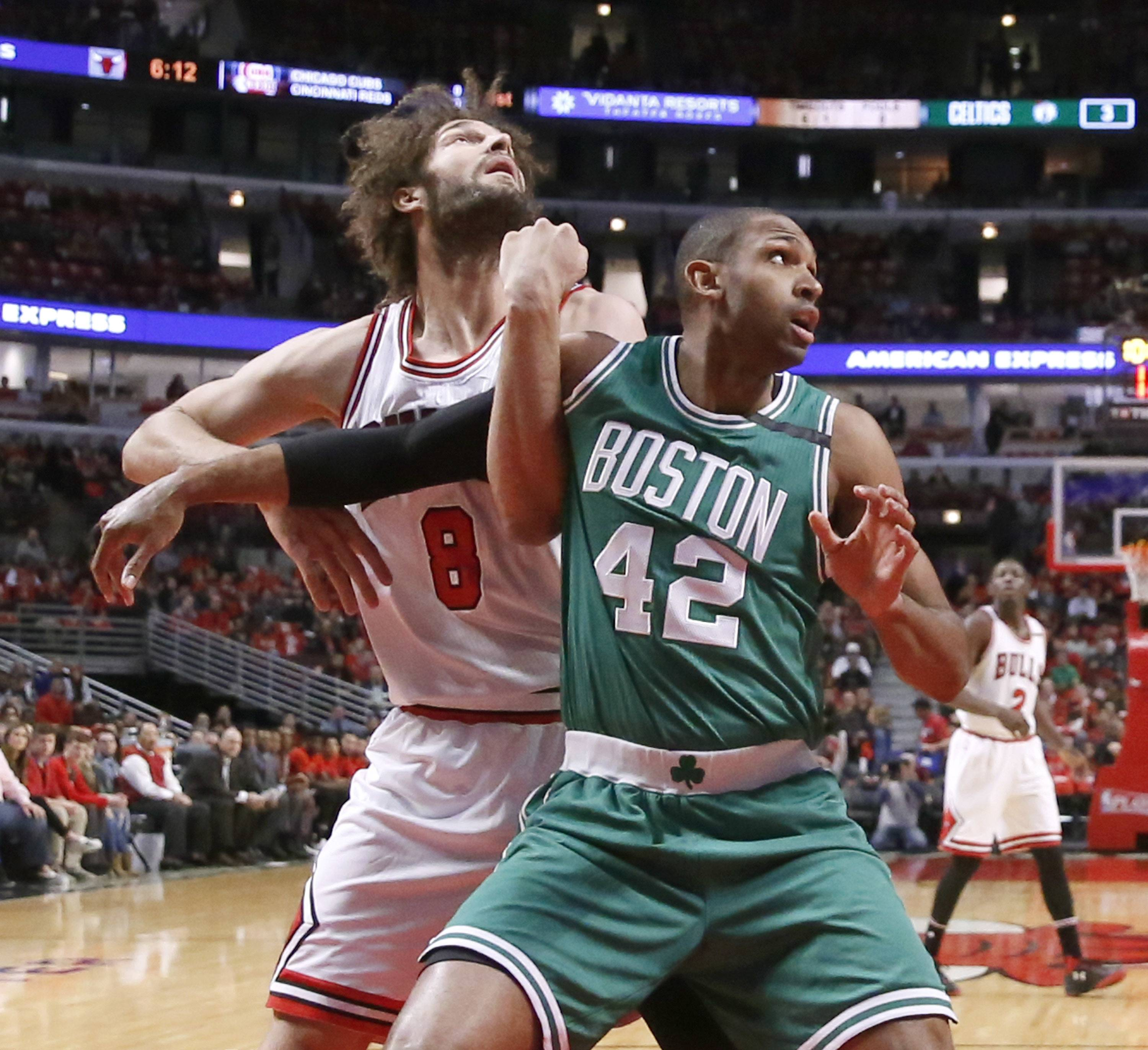 Chicago Bulls' Robin Lopez (8) and Boston Celtics' Al Horford vie for position during the first half of Game 3 of an NBA basketball first-round playoff series in Chicago, Friday, April 21, 2017, in Chicago. (AP Photo/Charles Rex Arbogast)