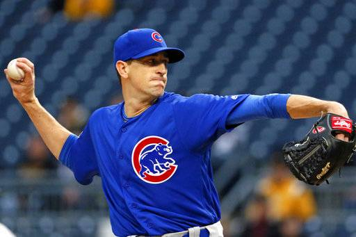 Chicago Cubs starting pitcher Kyle Hendricks winds up during the first inning of the team's baseball game against the Pittsburgh Pirates in Pittsburgh, Tuesday, April 25, 2017. (AP Photo/Gene J. Puskar)