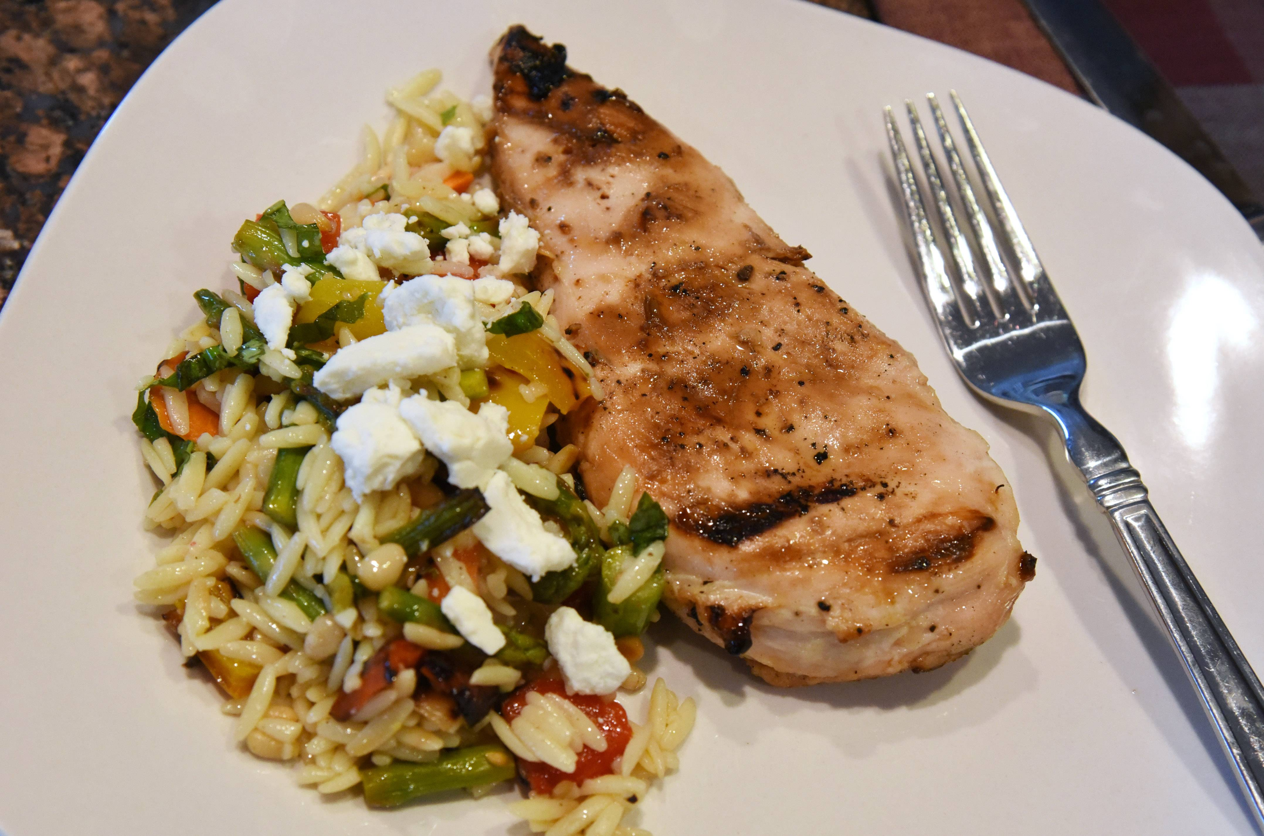 Grilled vegetable and orzo salad alongside Graduation Party Chicken made by Lake Zurich Cook of the Week Kim Schroeder.