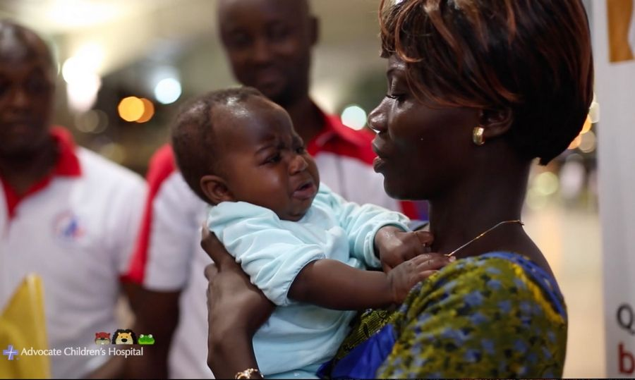 Baby Dominique is reunited with her mother in Ivory Coast after her successful surgery in the suburbs.