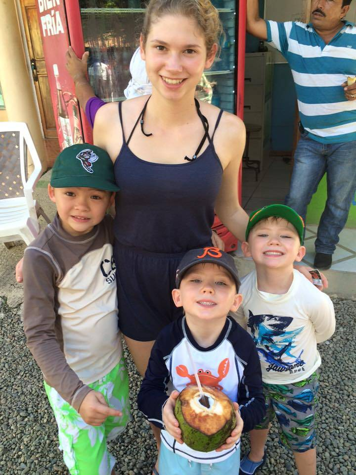 Au pair Julia Brockmeyer with the Donehoo boys in Costa Rica. From left are Teige, Brenn and Finn.