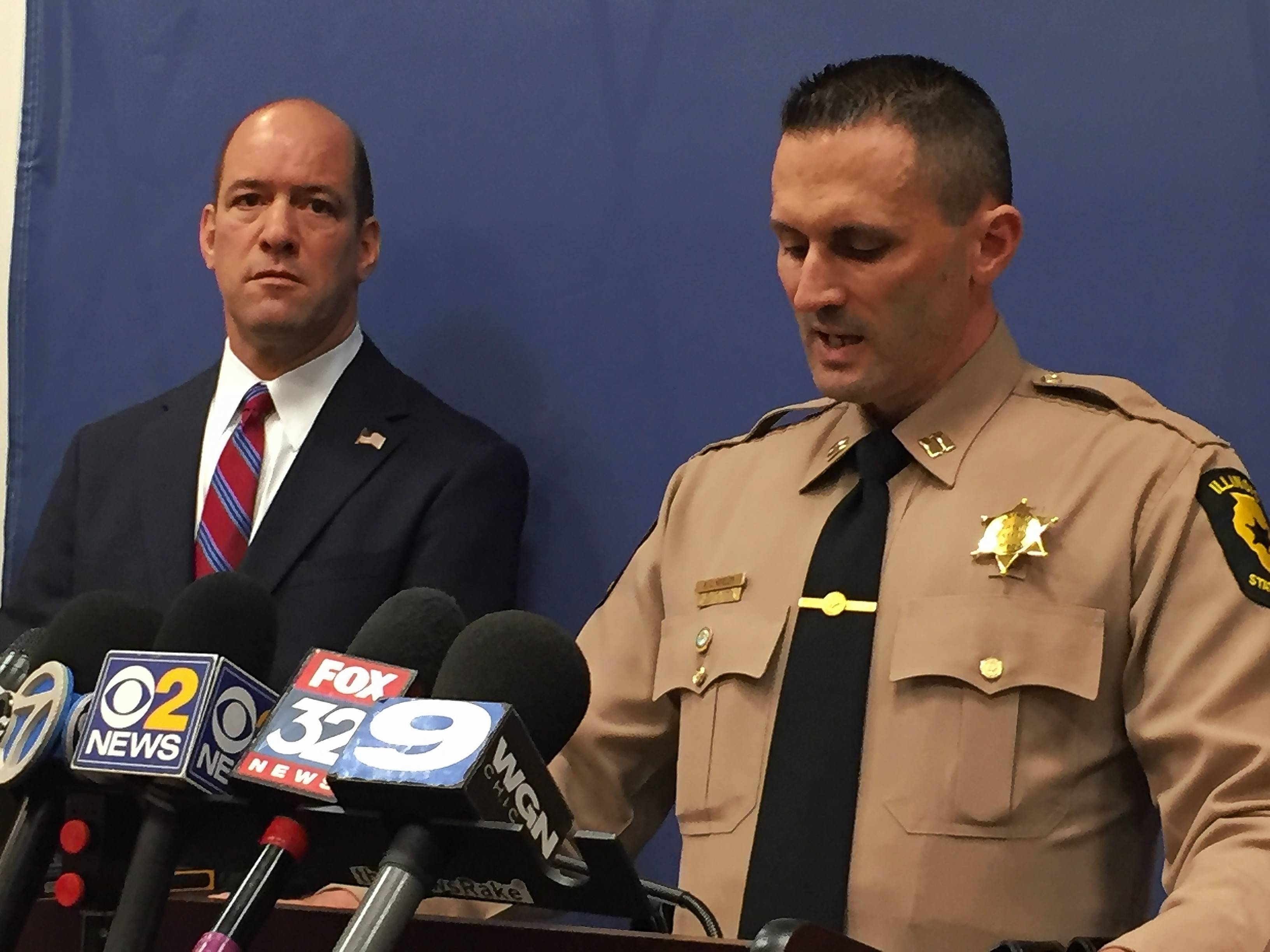 Illinois State Police Capt. Robert Meeder, right, and DuPage County State's Attorney Robert Berlin outline charges in an apparent road-rage shooting in Oak Brook.