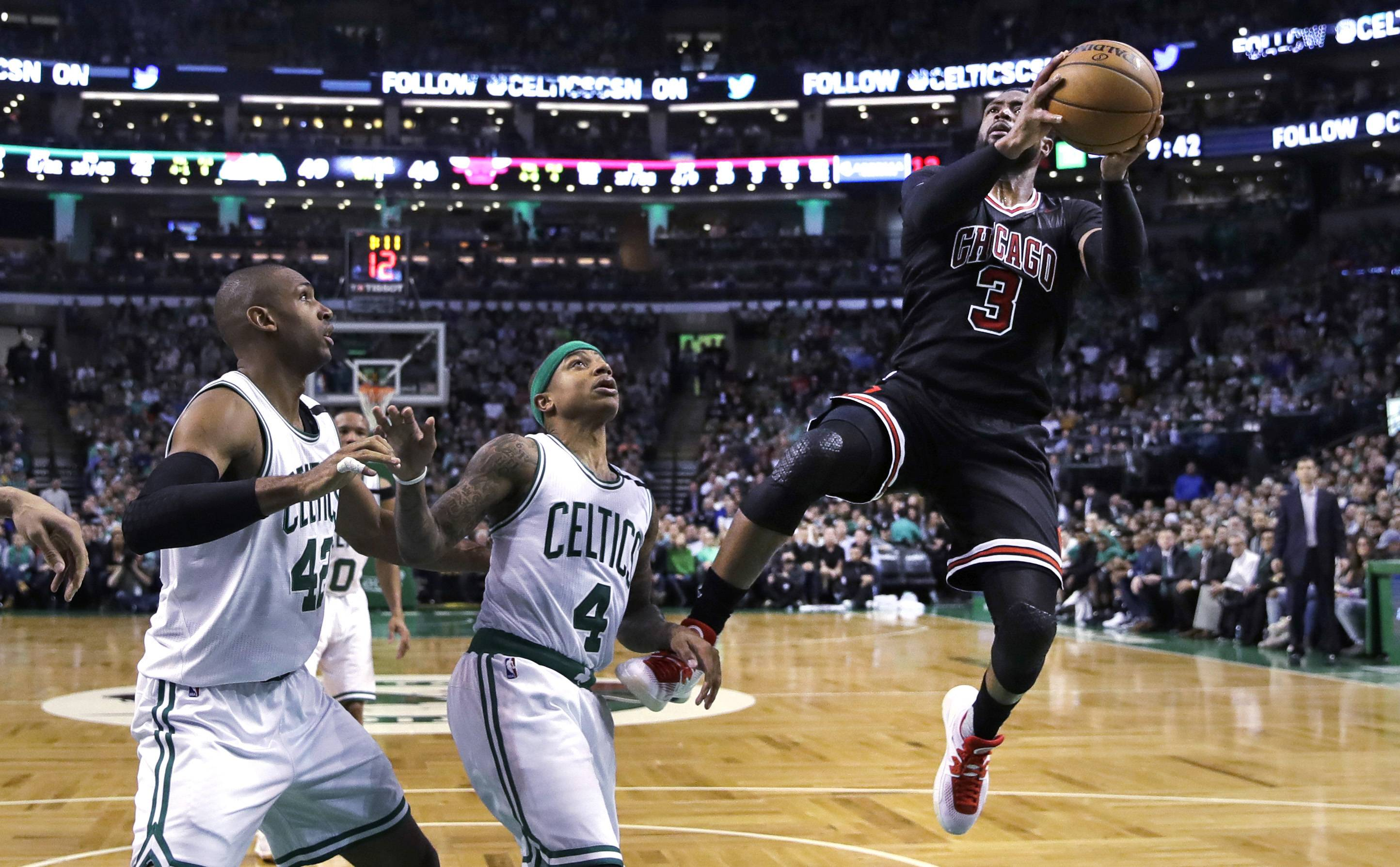 Bulls' guard Dwyane Wade shoots over Boston Celtics guard Isaiah Thomas (4) and center Al Horford (42) on a drive to the basket in the second quarter in Boston on Wednesday. Though Game 5 was competitive, this Bulls-Celtics series sure hasn't had much buzz.