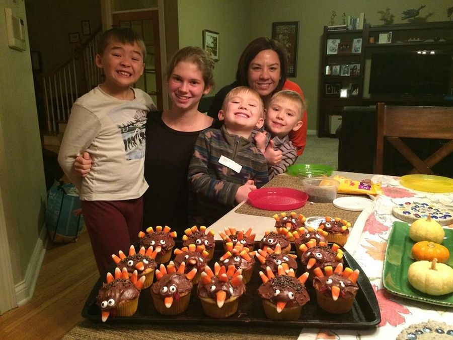 From left, Teige Donehoo, au pair Julia Brockmeyer, twins Finn and Brenn and the Donehoo boys' mother Cindy Ruesch at Thanksgiving dinner. Brockmeyer won an Au Pair of the Year award after spending a year with the St. Charles family.