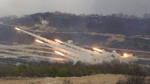 South Korean army's multiple launch rocket systems fire rockets during South Korea-U.S. joint military live-fire drills at Seungjin Fire Training Field in Pocheon, South Korea, near the border with North Korea, Wednesday. April 26, 2017. (AP Photo/Ahn Young-joon)