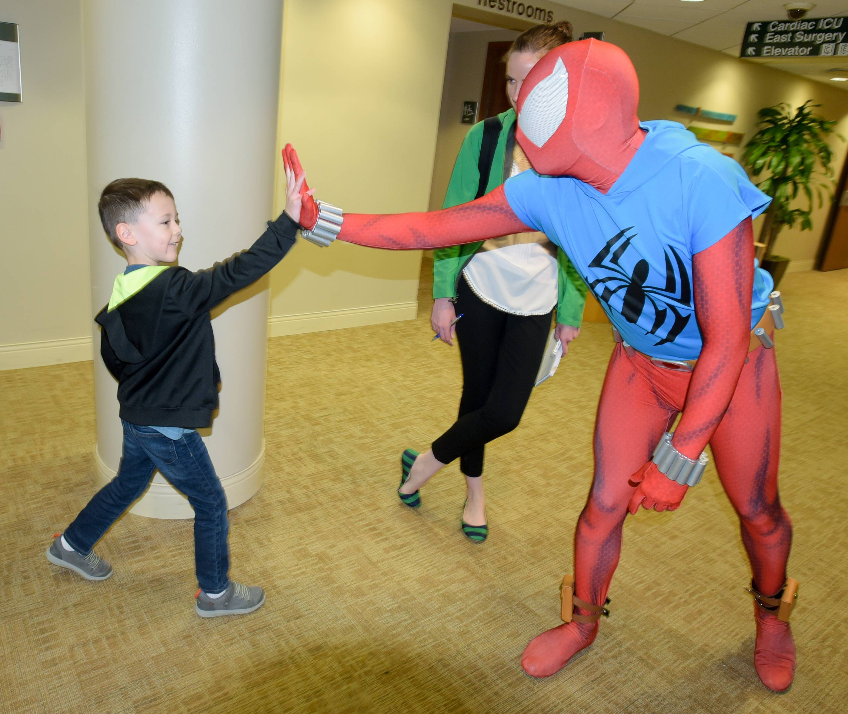 Eli Shambling, of Plainfield, gives Spider-Man a high-five as Northwestern Medicine Central DuPage Hospital celebrates Superhero Day.