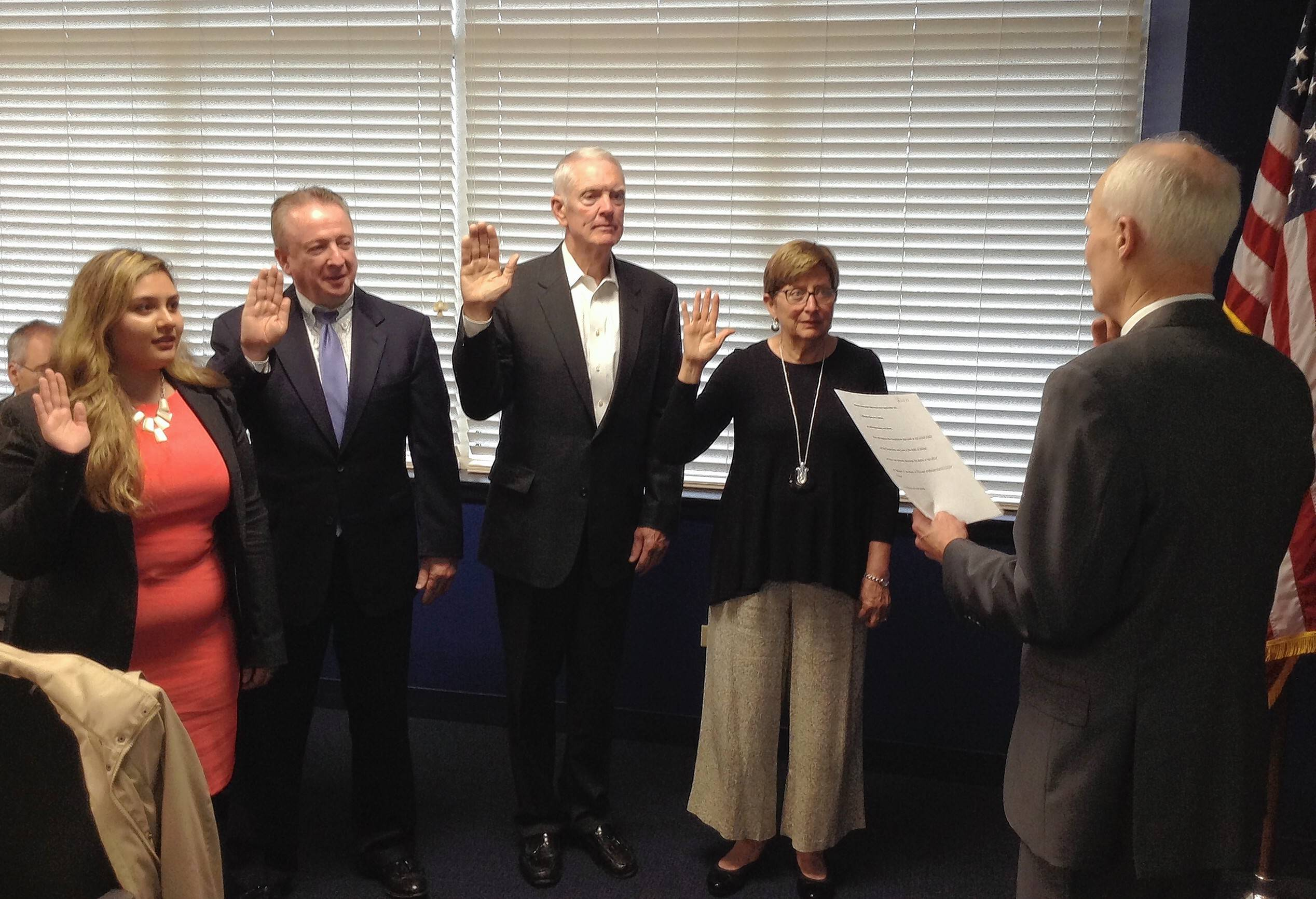 Harper College board members sworn in Wednesday include Student Trustee Niki Safakas, from left, and Trustees Walt Mundt, Herb Johnson and Pat Stack. They were given the oath of office by college attorney Phil Gerner.