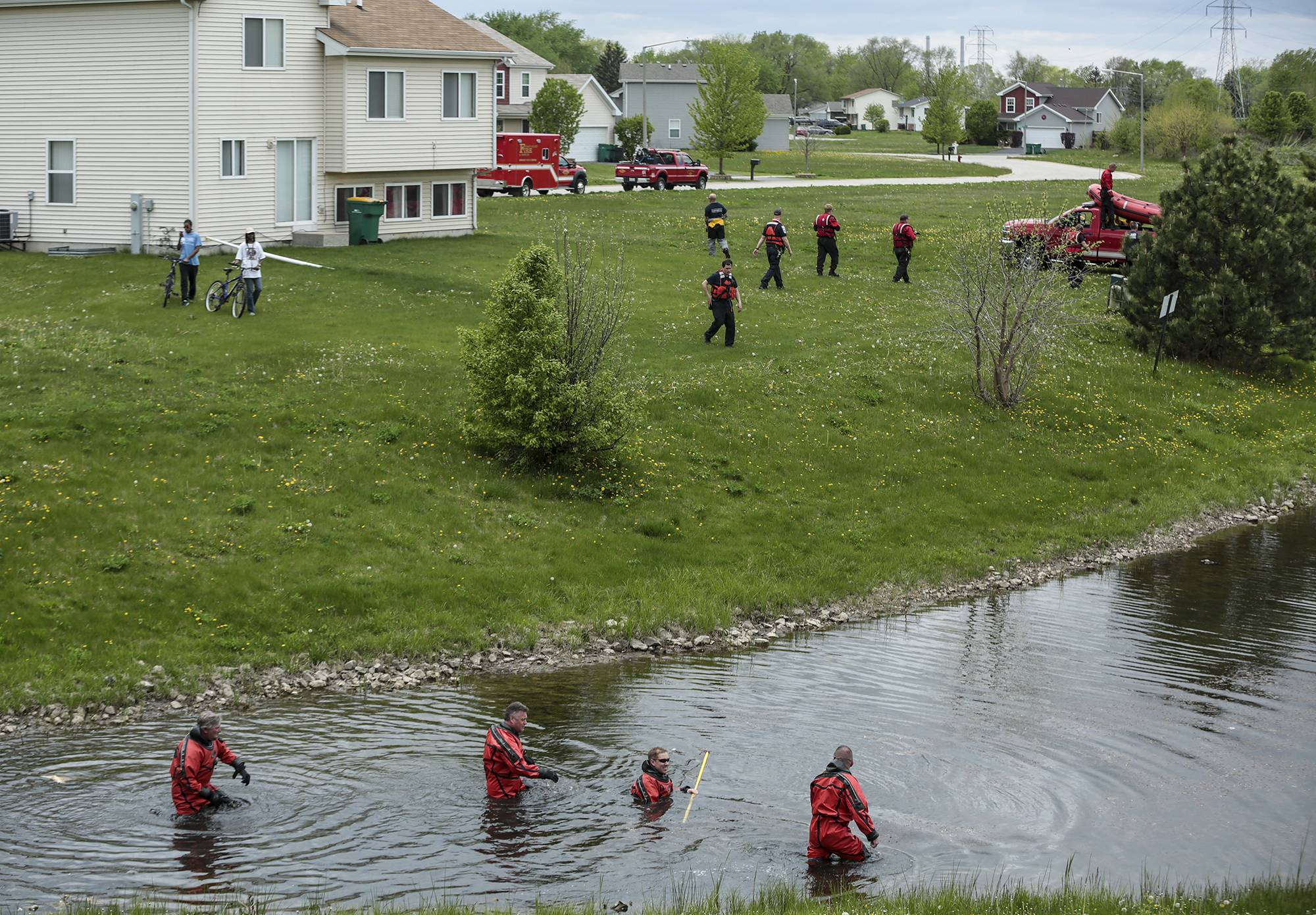 Emergency divers search the water in a nearby retention pond while searching for 1½-year-old Semaj Crosby in Joliet.