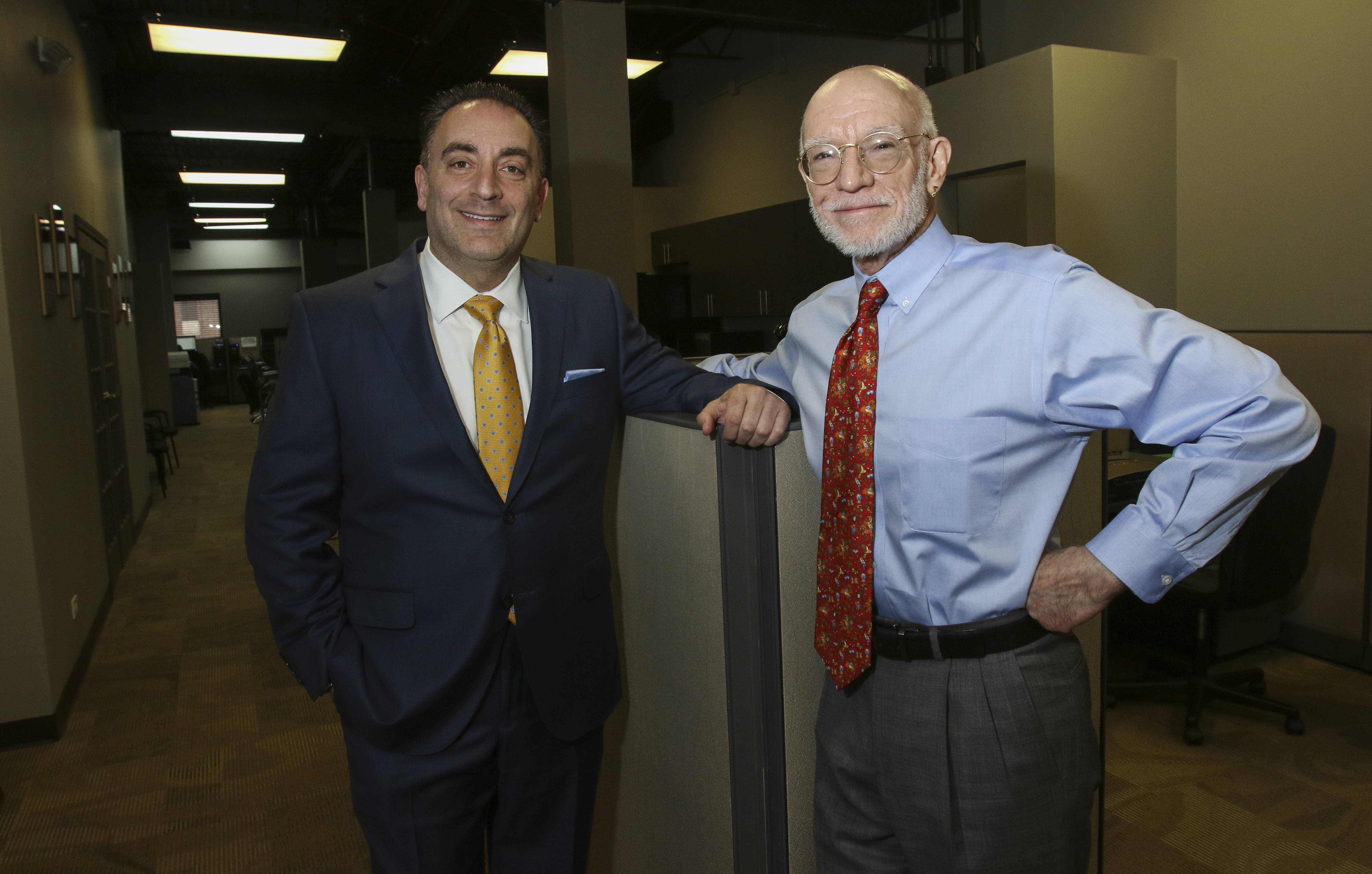 "David Litt, left, founder and CEO of Blue Star Technology in Bloomingdale, and George J. ""Lek"" Loechl, right, vice president of marketing and creative vision."